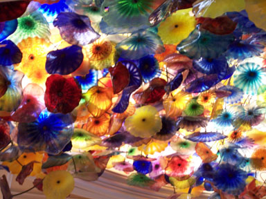 Chihuly handblown flowers cover the ceiling of Belaggio's hotel lobby.