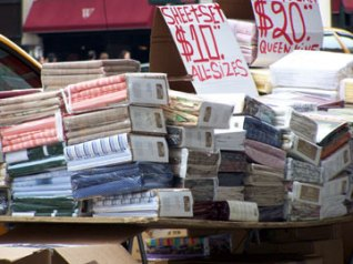 A table of high quality bedding was quickly set up on the SoHo sidewalk. All sheet sets $20.